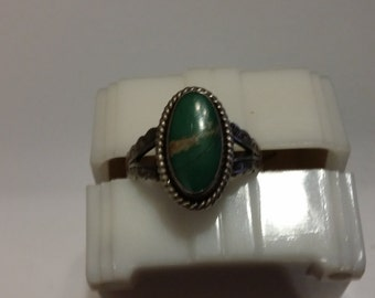 R 25       Sterling silver ring with green stone