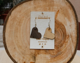 Love. Wooden earrings are cut and laser engravings.