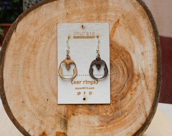 Pingus. Wooden earrings are cut and laser engravings.
