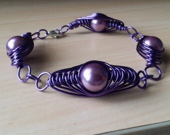 Purple herringbone wire bracelet with light purple beads