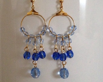 Gypsy Earring: Dangling earrings with crystals.