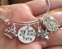 "Alice in wonderland Bracelet bangle bracelet adjustable bracelet-with rabbit clock tea kettle and cup and hand stamped ""we are all mad here"""