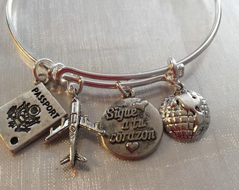 Spanish bracelet travel-Bracelet with airplane passport world  and stamped nunca es tarde or sigue a tu corazon charms
