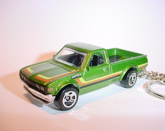 3D Datsun 620 custom keychain by Brian Thornton keyring key chain finished in green color trim metal body pick up truck