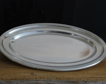 Large vintage French silver plate oval shaped serving dish in good overall vintage condition. 1950s