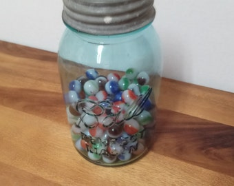 Vintage blue ball jar with marbles