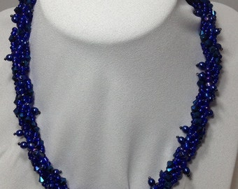 Blue embellished spiral necklace