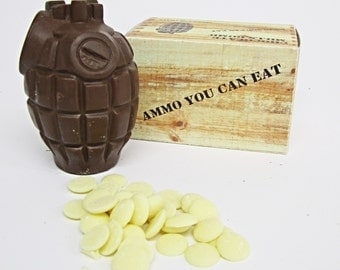 Milk chocolate hand grenade with white chocolate buttons