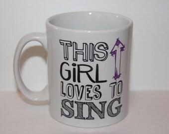 Shmug Personalised 'This girls loves to.... sing' gift, printed mug/cup