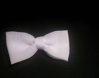 White fabric bow with alligator clip