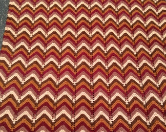 Knitted Chevron Afghan. 36 x 45 in.  Cream, brown, mustard, plum.