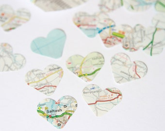Heart shaped map confetti, made using genuine map and atlas pages, each 1 inch heart hand stamped