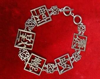 "925 St/Silver Figural Panel Bracelet. 22 gm  9"" Long."