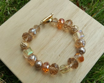 Brown, Rust and Beige beads, Gold metal accents and toggle clasp