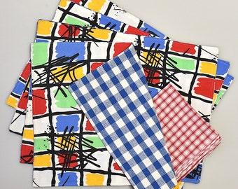 Reversible Placemats/Coordinating Napkins made from repurposed fabrics in red/blue/yellow.
