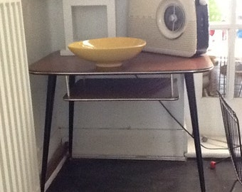 1950s side table with small magazine rack underneath.
