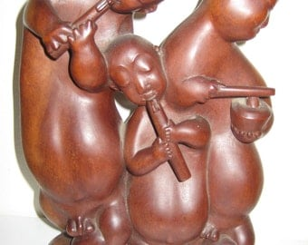 Three Hand Carved Buddhas Playing Their Flutes