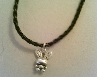 Silver coloured Rabbit with leather necklace.