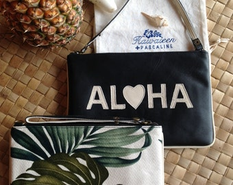 Leather purses. ALOHA clutch
