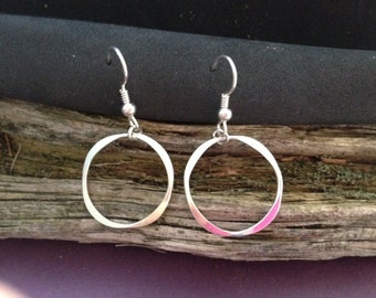 Round shape forged dangle silver earring.