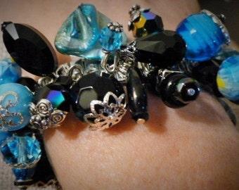 Spandex Bracelet #72 by Tricia. Teal, Blue, Black Jet, on Stainless steel.