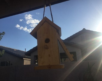 Wooden birdhouse with side door