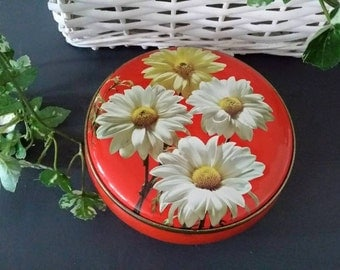 Red vintage can with daisy photo print.