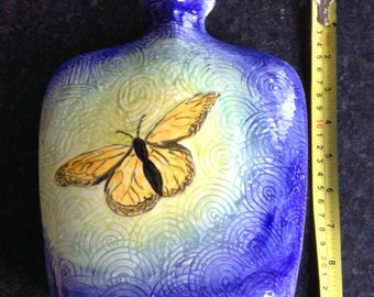 Ceramic pottery vase with butterfly