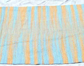 handwoven blue and orange cotton thread tablerunner