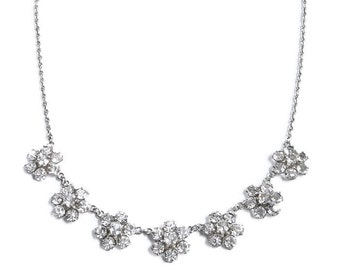 Sterling silver, open back, crystal necklace. Seven rhinestone flowers. Vintage, retro.