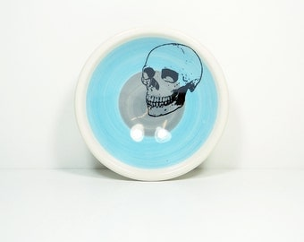 small dish, with a badass skull on a color block of sky blue & storm, made to order.