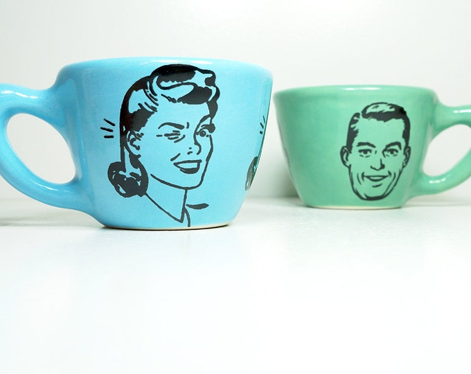 a pair of 12oz cups with a guy & a gal, seen here glazed in Cloudless and Blue Green, made to order / pick your colour.