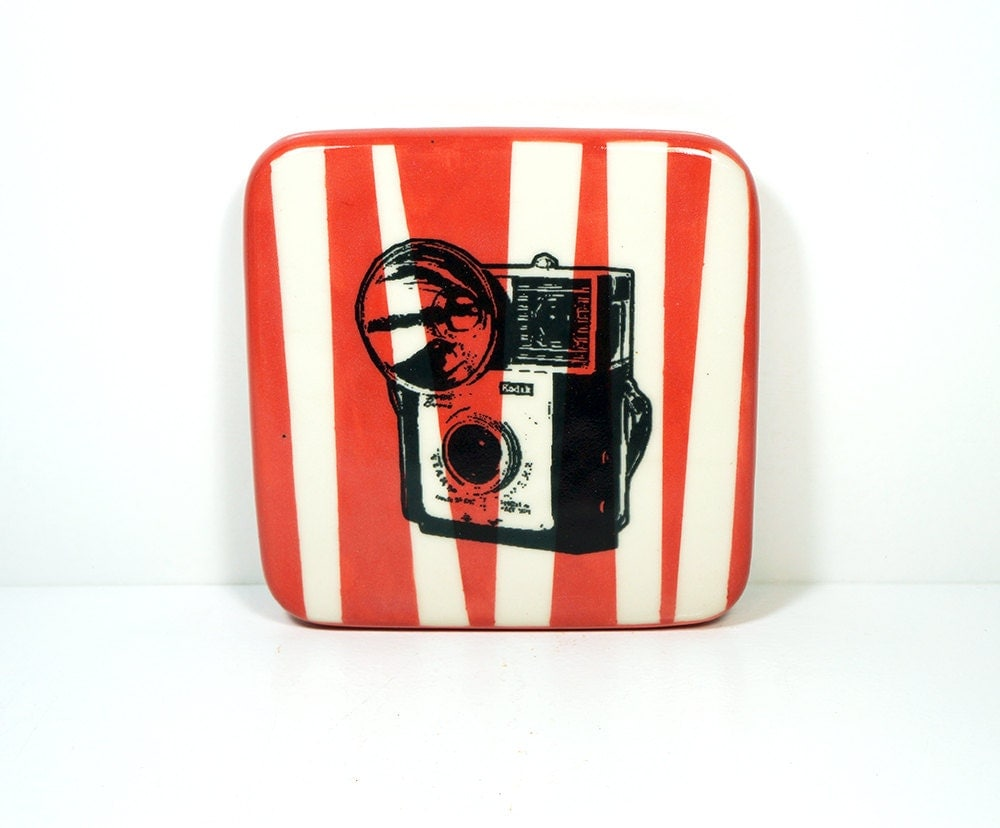 tile with a kodak starmite camera on various asymmetrical red-orange stripes, made to order.