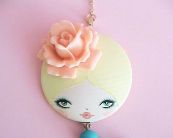 Coralee Doll face Necklace