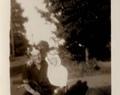 vintage photo Guy and gal Ride a Motorcycle Goggles and White Cape