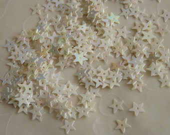 New item -- 7g of  7 mm Star Sequins in Opaque Iridescent Cream Color (approximately 1100 ct.)