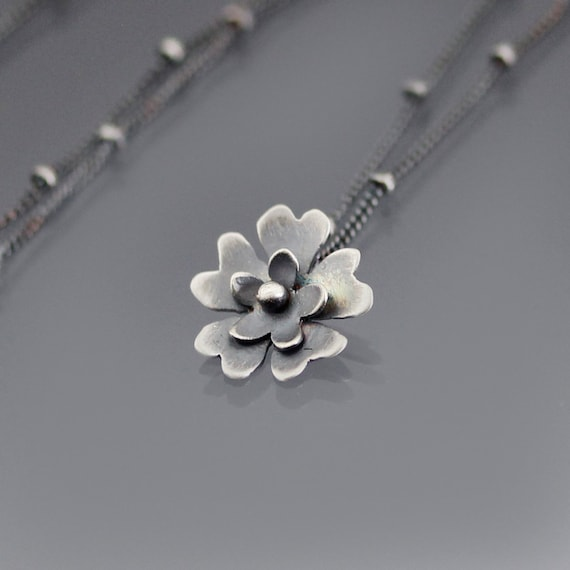 Tiny silver blossom necklace flower pendant for Gemsprouts tiny plant jewelry