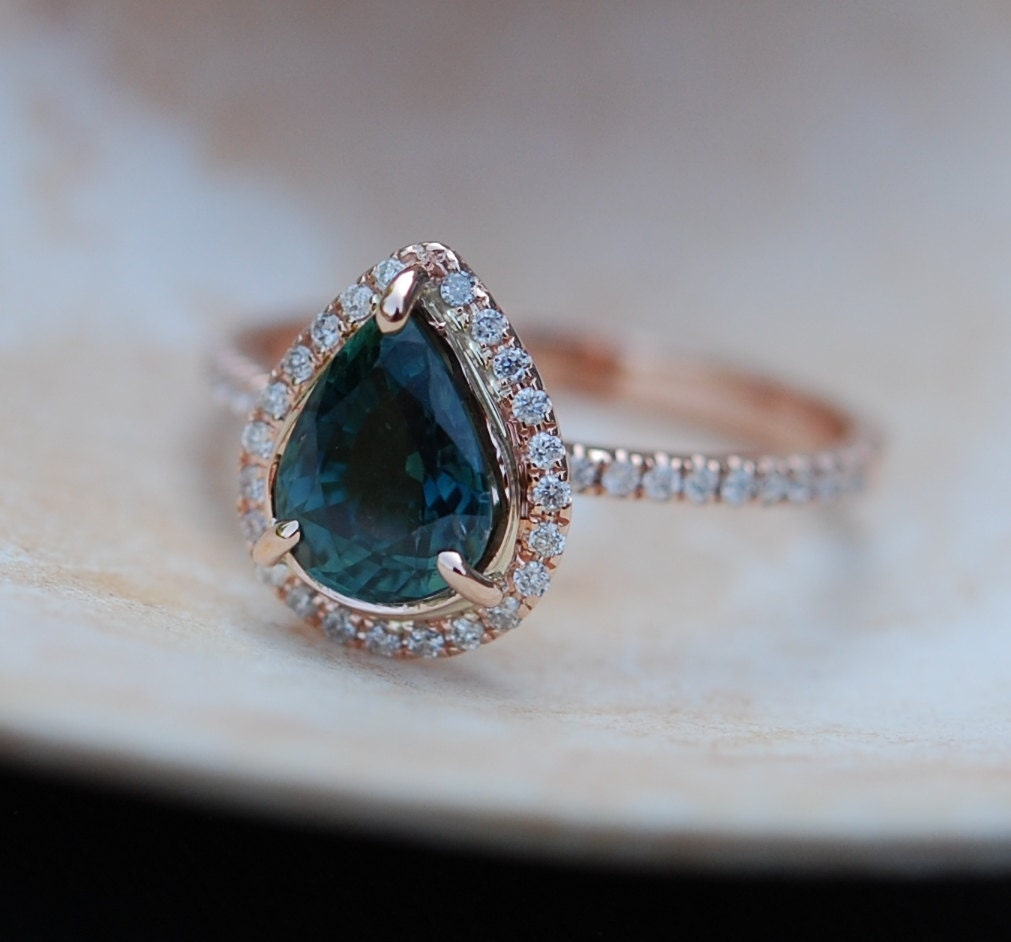 gold engagement ring peacock blue green sapphire pear cut