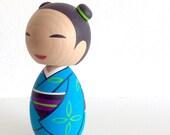 Kokeshi doll. Kimono girl in Blue