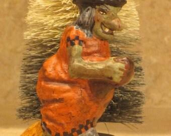 Paper mache Halloween Orange Witch on Broom