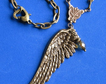 Oxidized brass Wing Necklace, Vintage style faceted fire polished glass bead suspended from a charm connector
