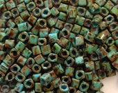 4mm TOHO Turquoise Picasso Cube Beads - 20gr