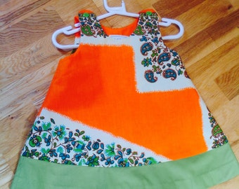 Sleeveless toddler summer dress in Orange African print with green border