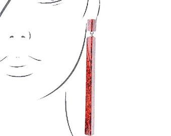 Handmade large long chandelier drop facet geometric statement dangle resin earrings in ruby red glitter sparkle.