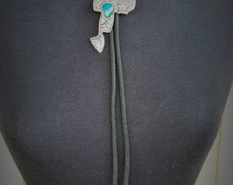 Faux Turquoise Set in Silver Toned Metal Saddle Bolo Tie