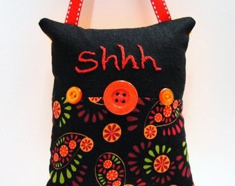Shhh pillow- doorknob pillow hand embroidered in red on black, orange, red and green with button embellishments