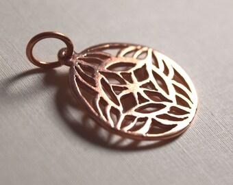 Small copper pendant, pierced, smooth, floret, original design