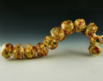 handmade lampwork glass bead set of 11 organic rondelles with multicolored frit topped with goldstone  - Gold Carnival