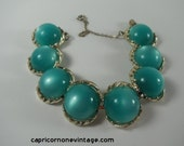 ON HOLD 1960s Coro Bracelet Teal Green Moonglow Thermoset Plastic Vintage Jewelry Safety Chain Gold Tone Metal