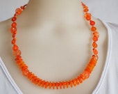 Orange button necklace handmade with reclaimed recycled upcycled buttons and beads.